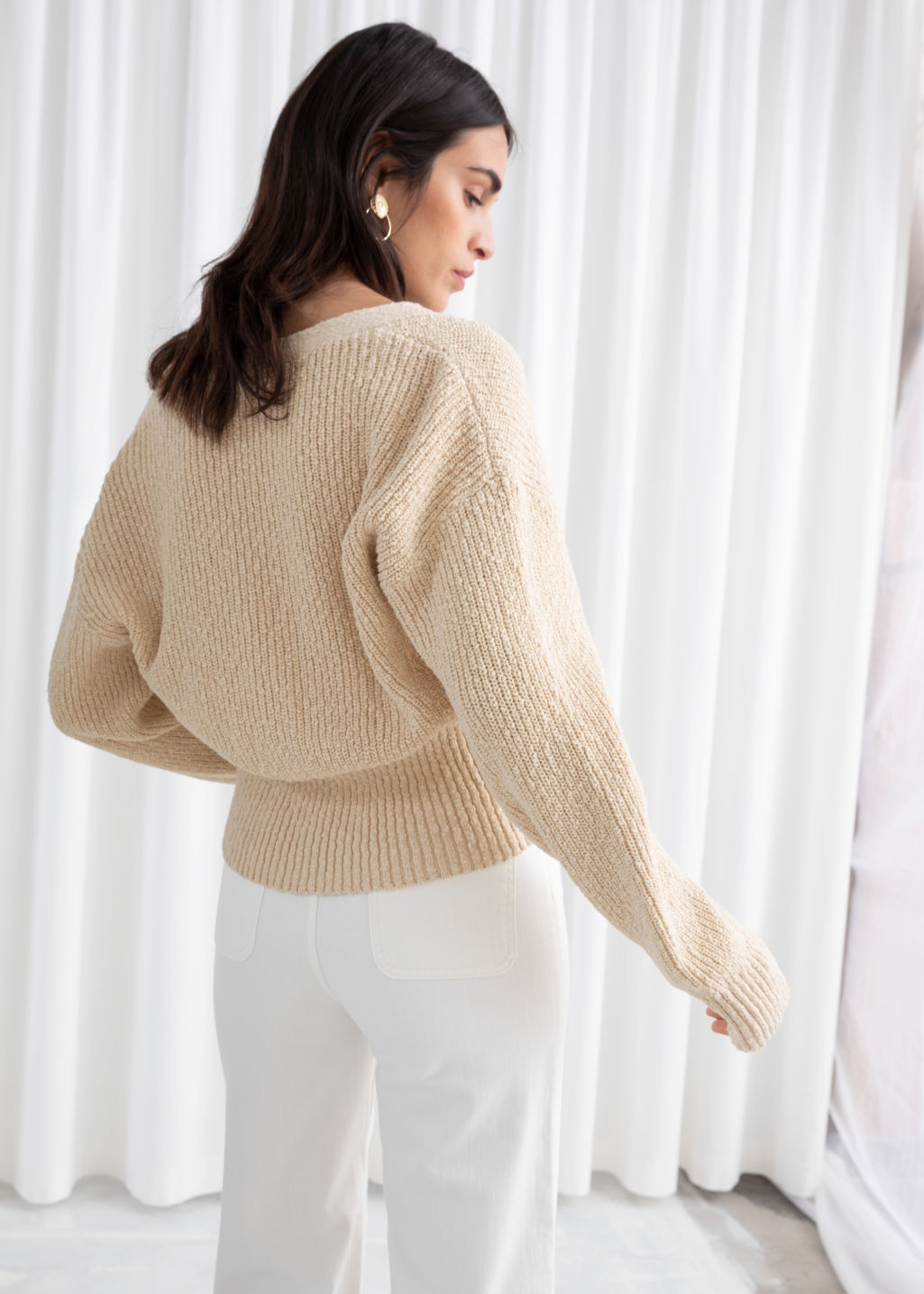 Model back image of Stories cropped textured cotton cardigan in beige