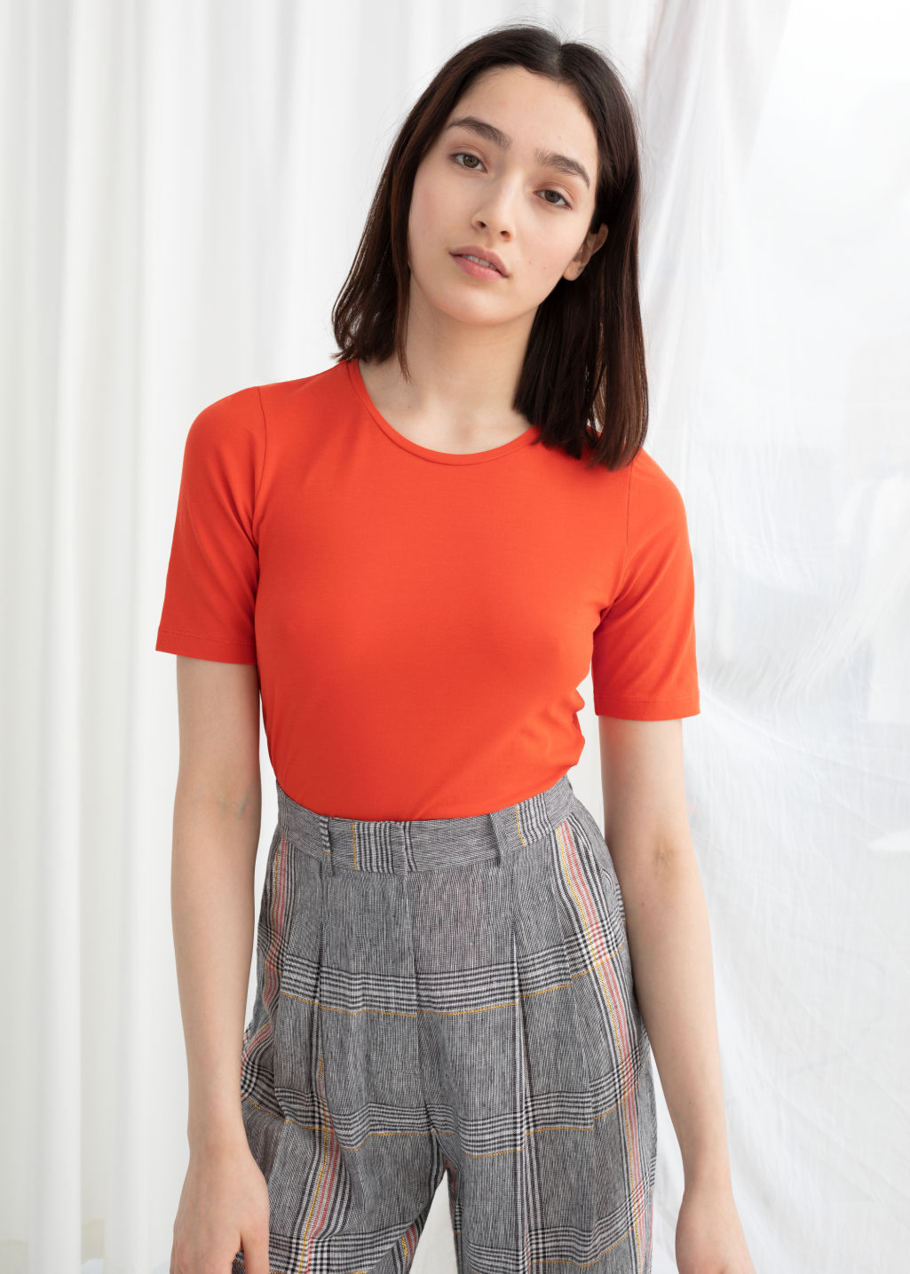 Model front image of Stories stretch cotton tee in orange
