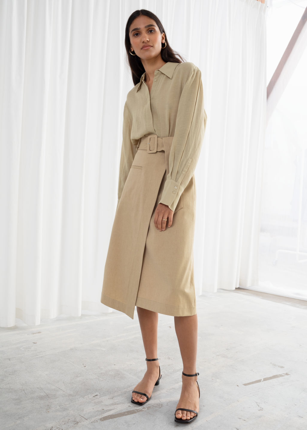 Model front image of Stories belted asymmetric midi skirt in beige