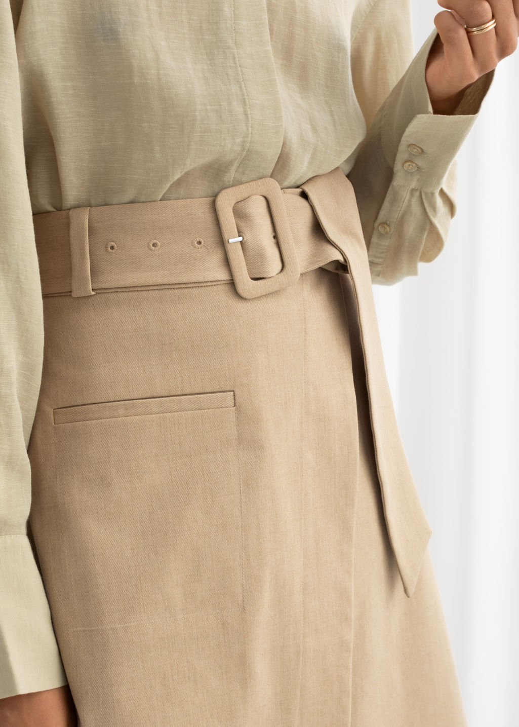 Model back image of Stories belted asymmetric midi skirt in beige