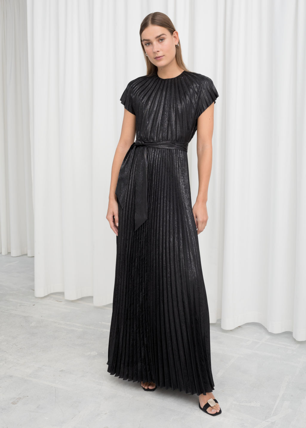 Model front image of Stories metallic pleated maxi dress in black