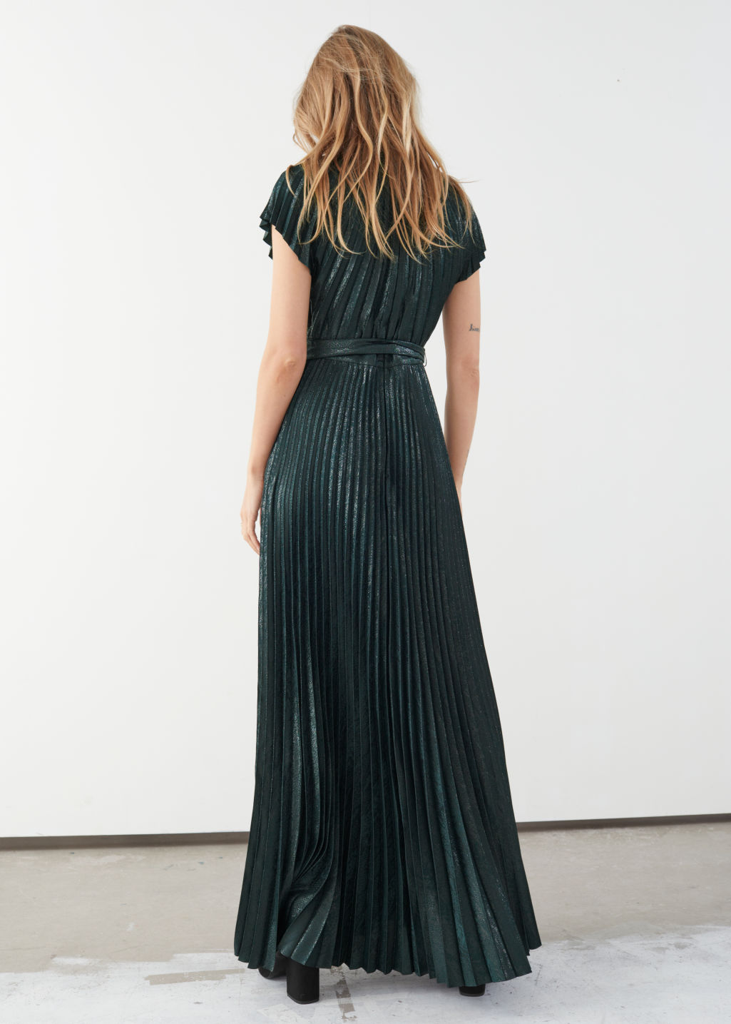 Model back image of Stories metallic pleated maxi dress in green
