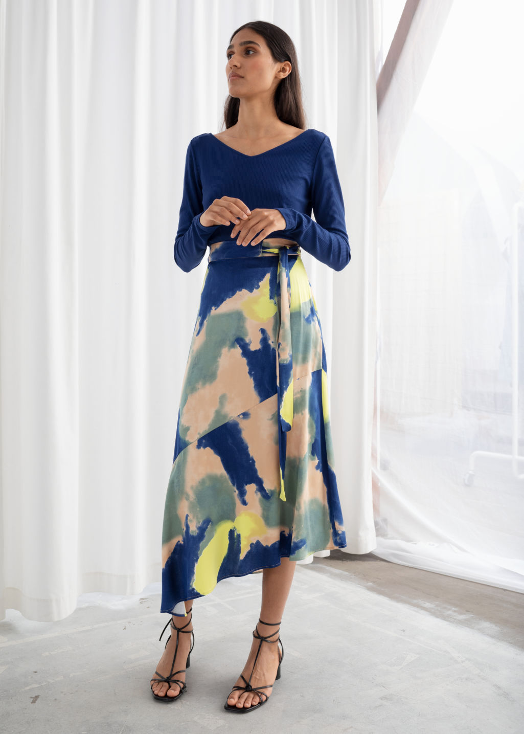 Model front image of Stories asymmetric satin midi skirt in blue