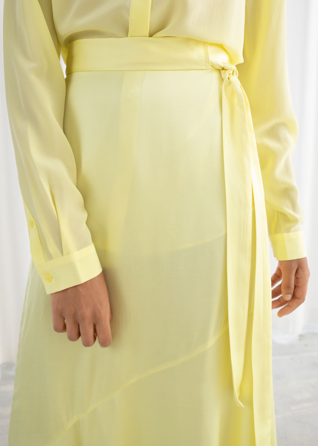Model back image of Stories asymmetric satin midi skirt in yellow