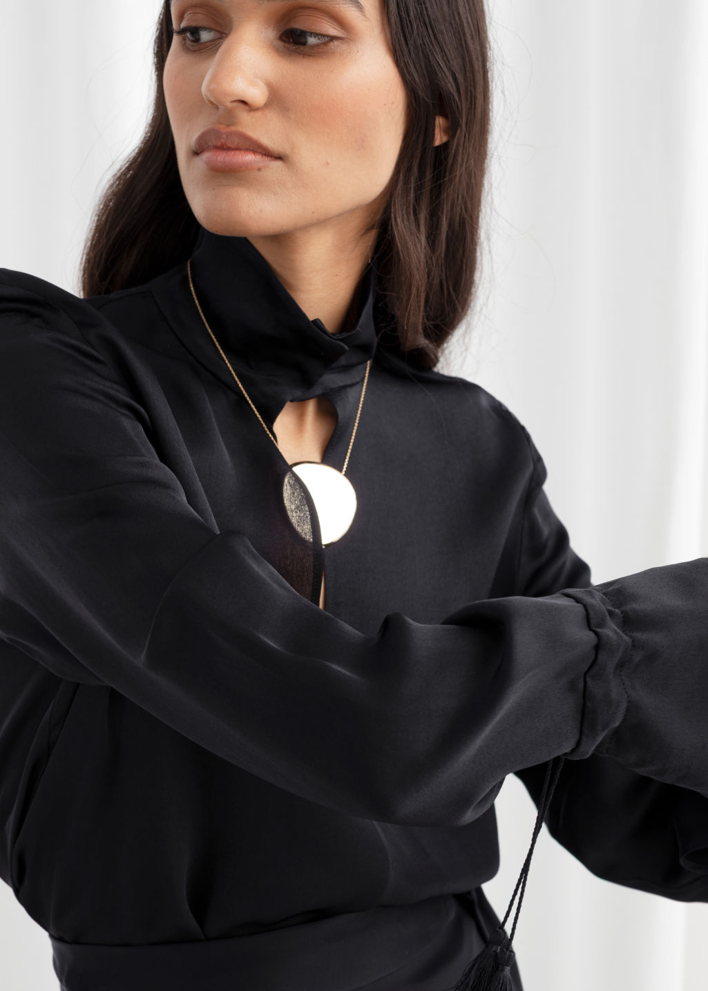 Model front image of Stories satin turtleneck blouse in black