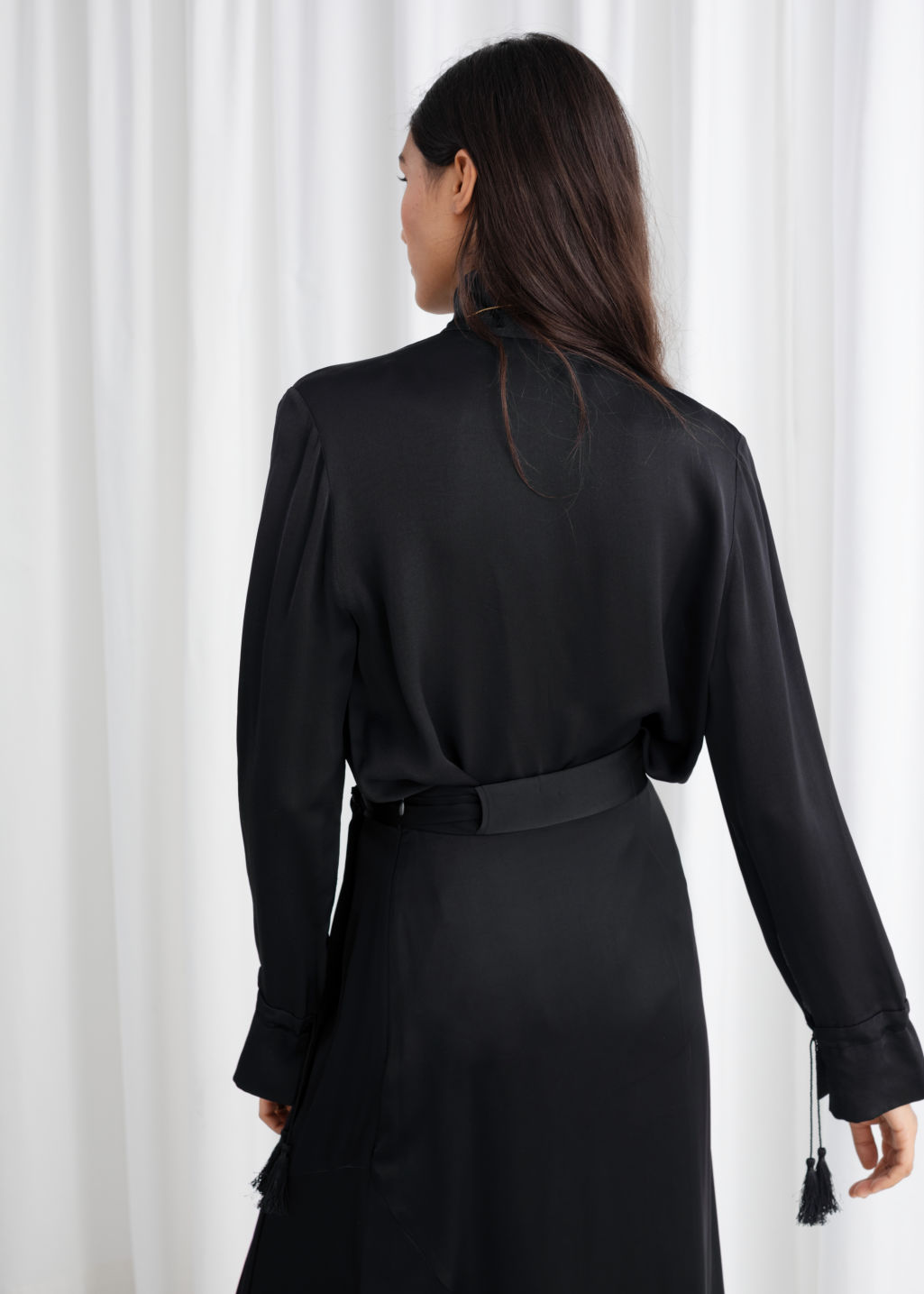 Model back image of Stories satin turtleneck blouse in black