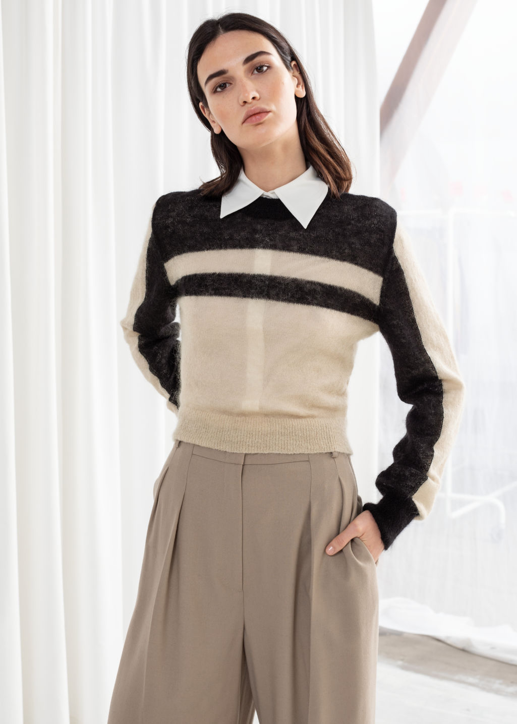 Model front image of Stories cropped striped sweater in black