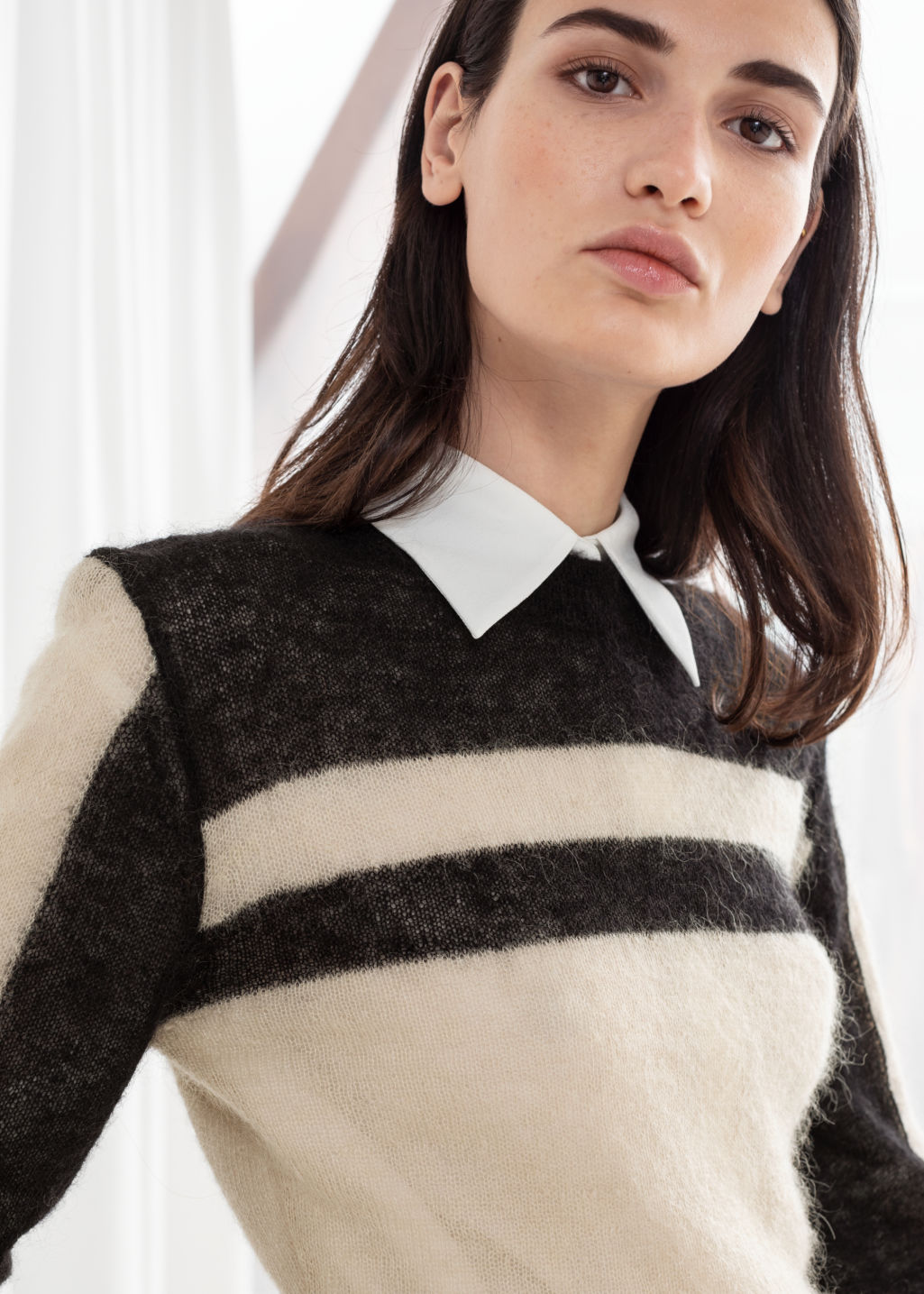 Model back image of Stories cropped striped sweater in black