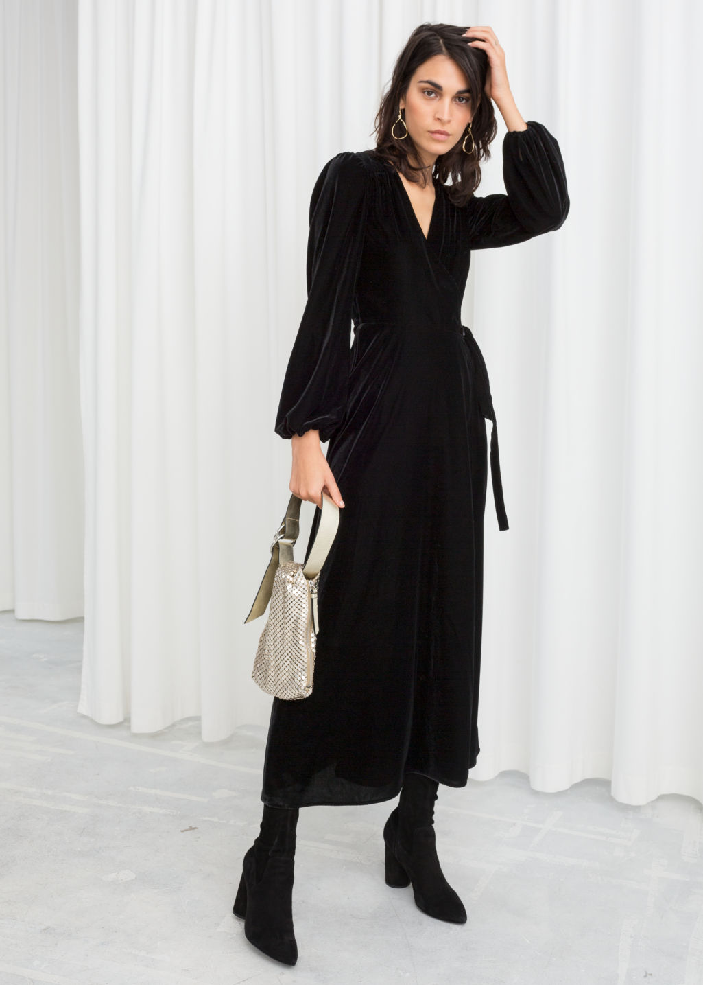 Model front image of Stories velvet midi wrap dress in black