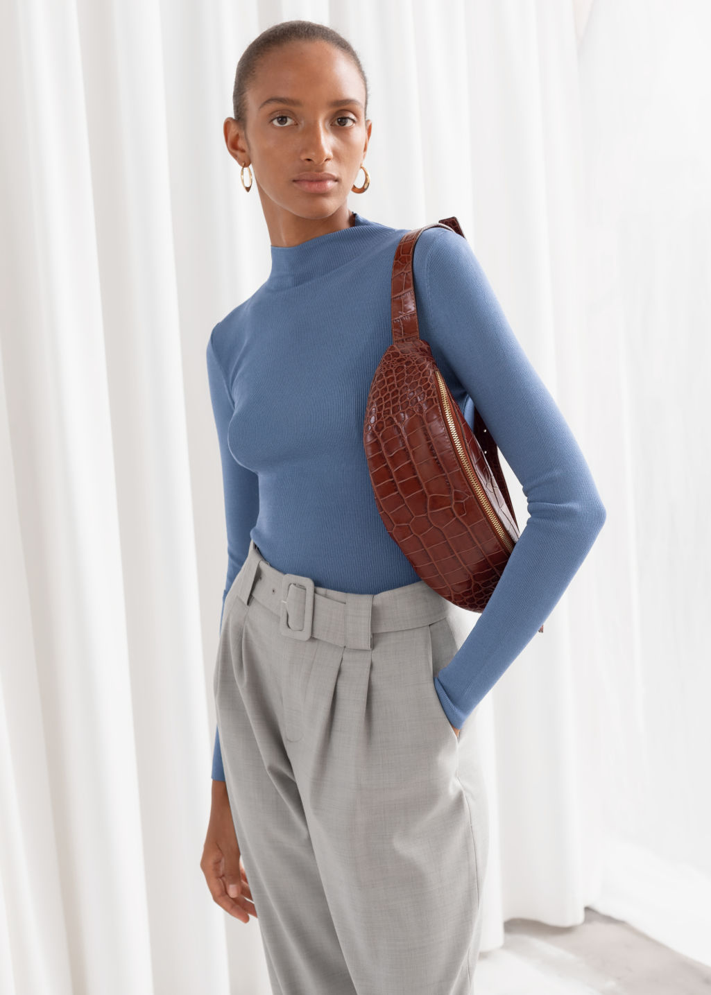Model front image of Stories fitted micro knit turtleneck in blue