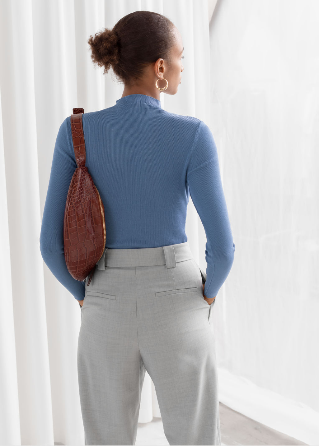 Model back image of Stories fitted micro knit turtleneck in blue