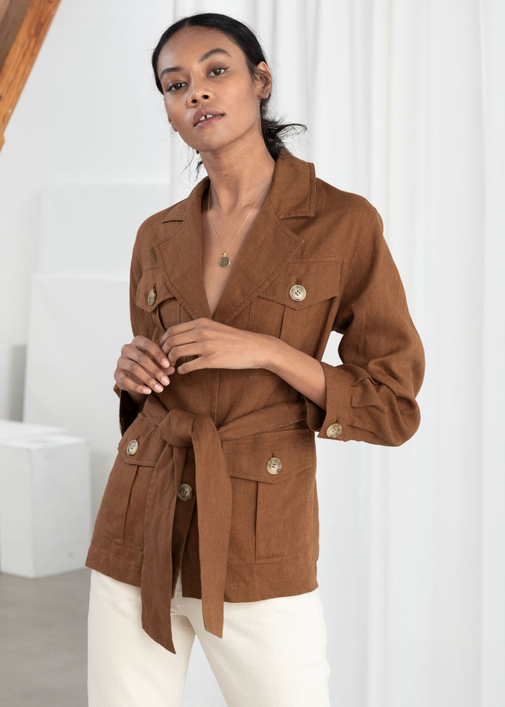 Model front image of Stories belted linen workwear jacket in beige