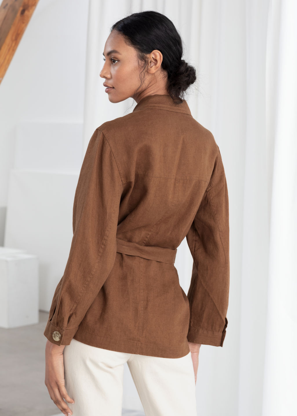 Model back image of Stories belted linen workwear jacket in beige