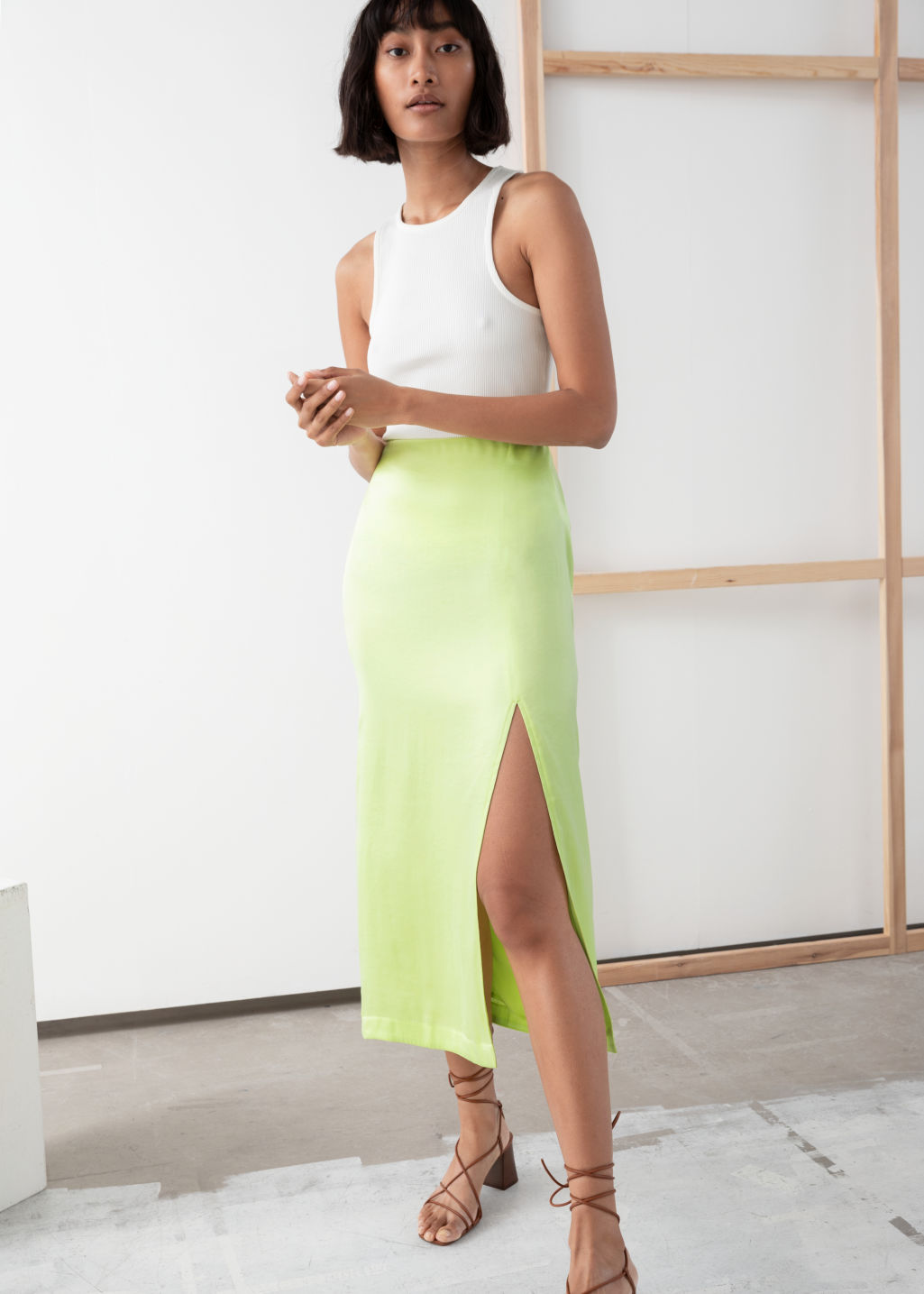Model front image of Stories side slit midi skirt in yellow