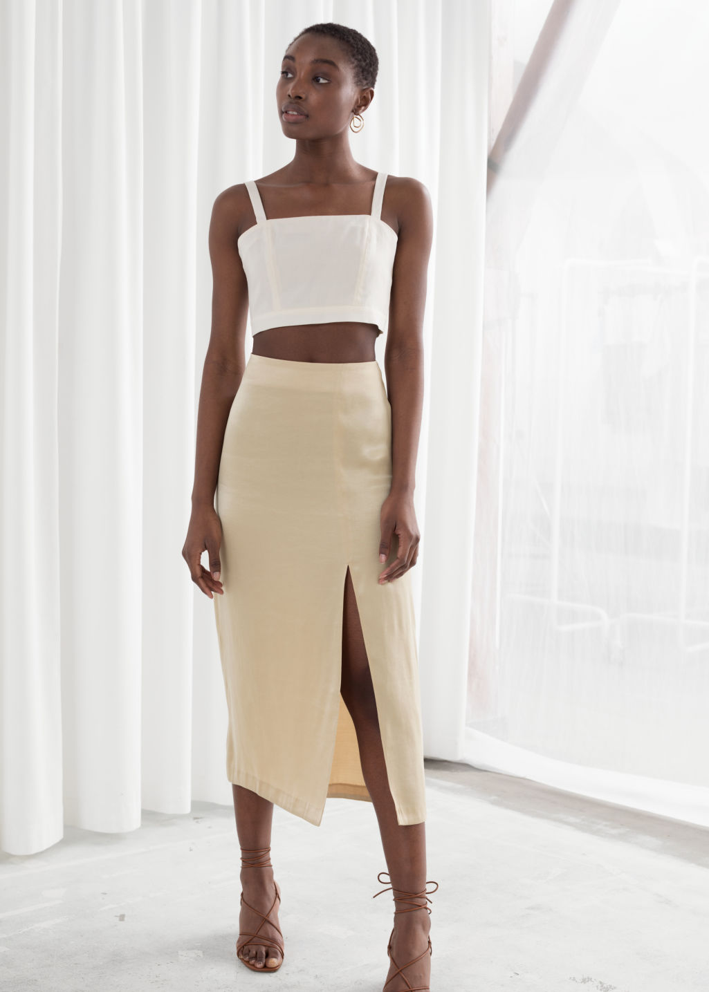 Model front image of Stories side slit midi skirt in beige