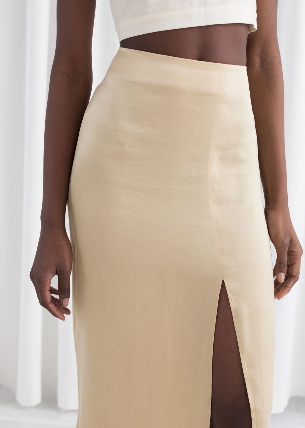Model back image of Stories side slit midi skirt in beige