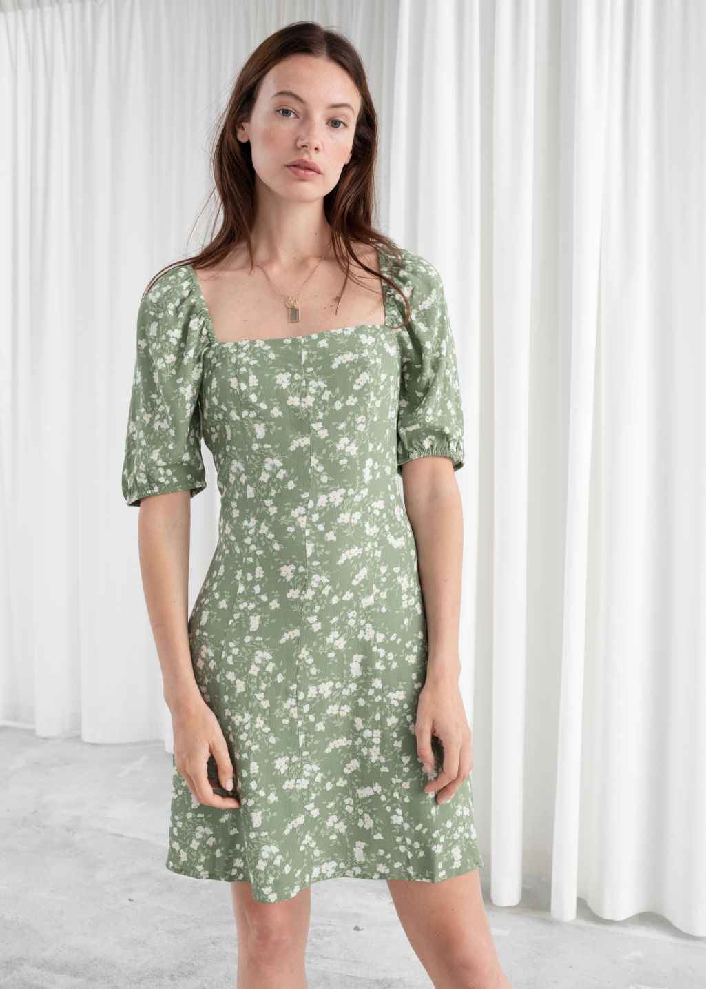 Model front image of Stories puff sleeve mini dress in green