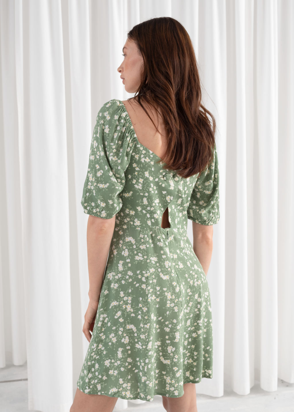 Model back image of Stories puff sleeve mini dress in green