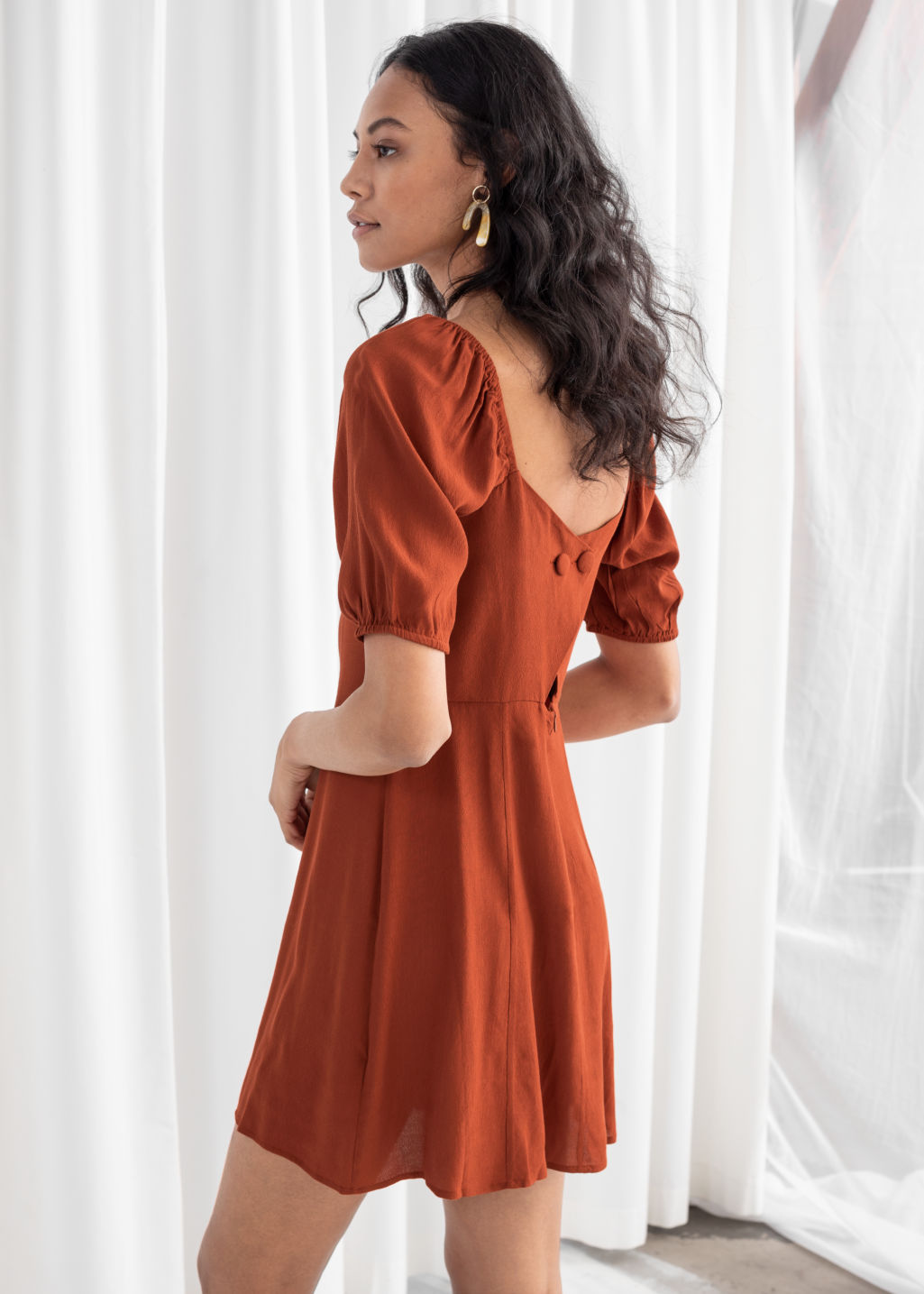 Model back image of Stories puff sleeve mini dress in orange