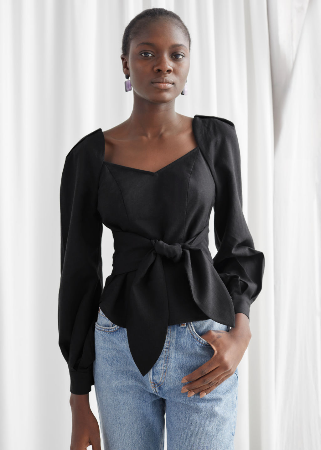 Model front image of Stories tie waist blouse in black