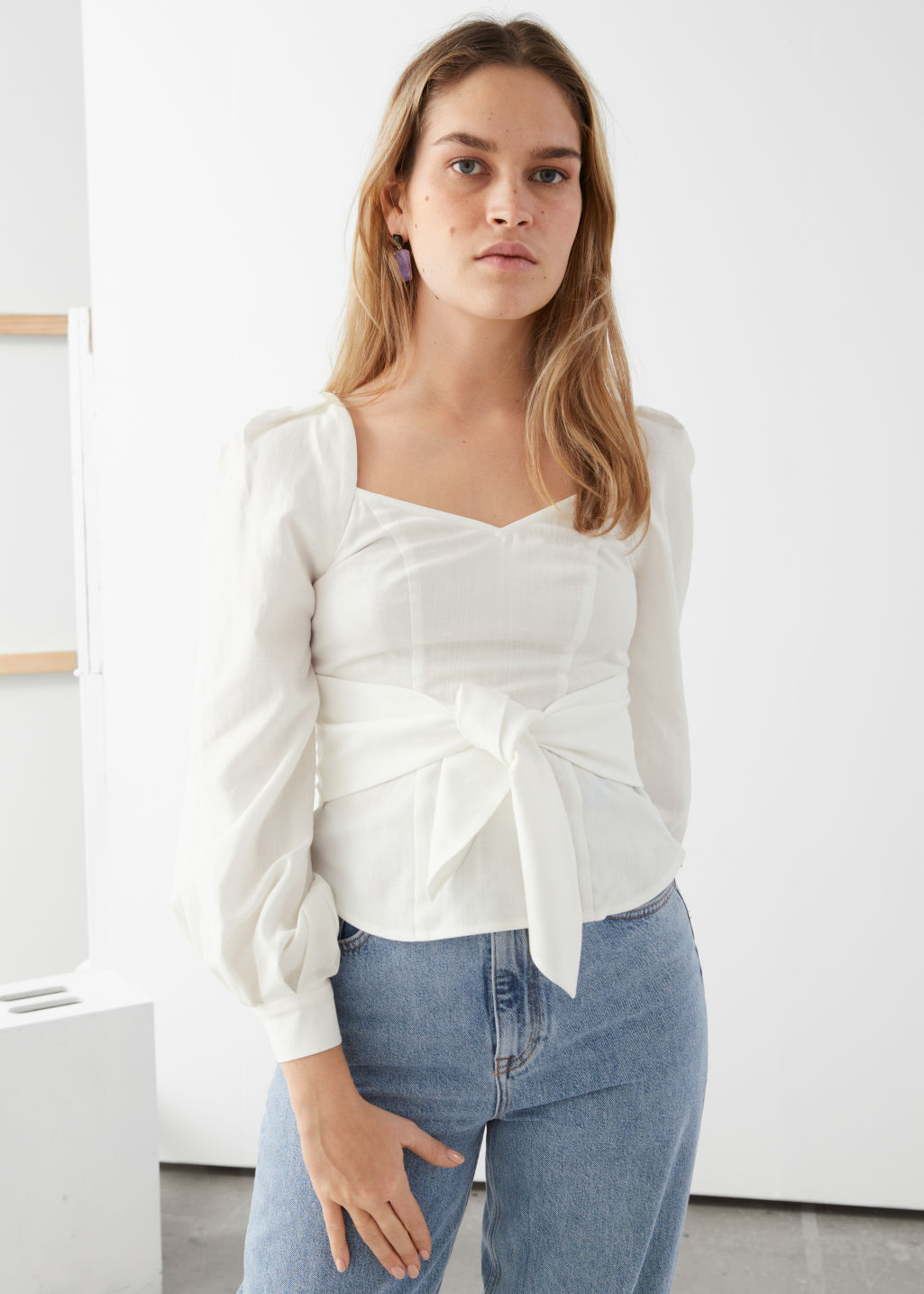 Model front image of Stories tie waist blouse in white