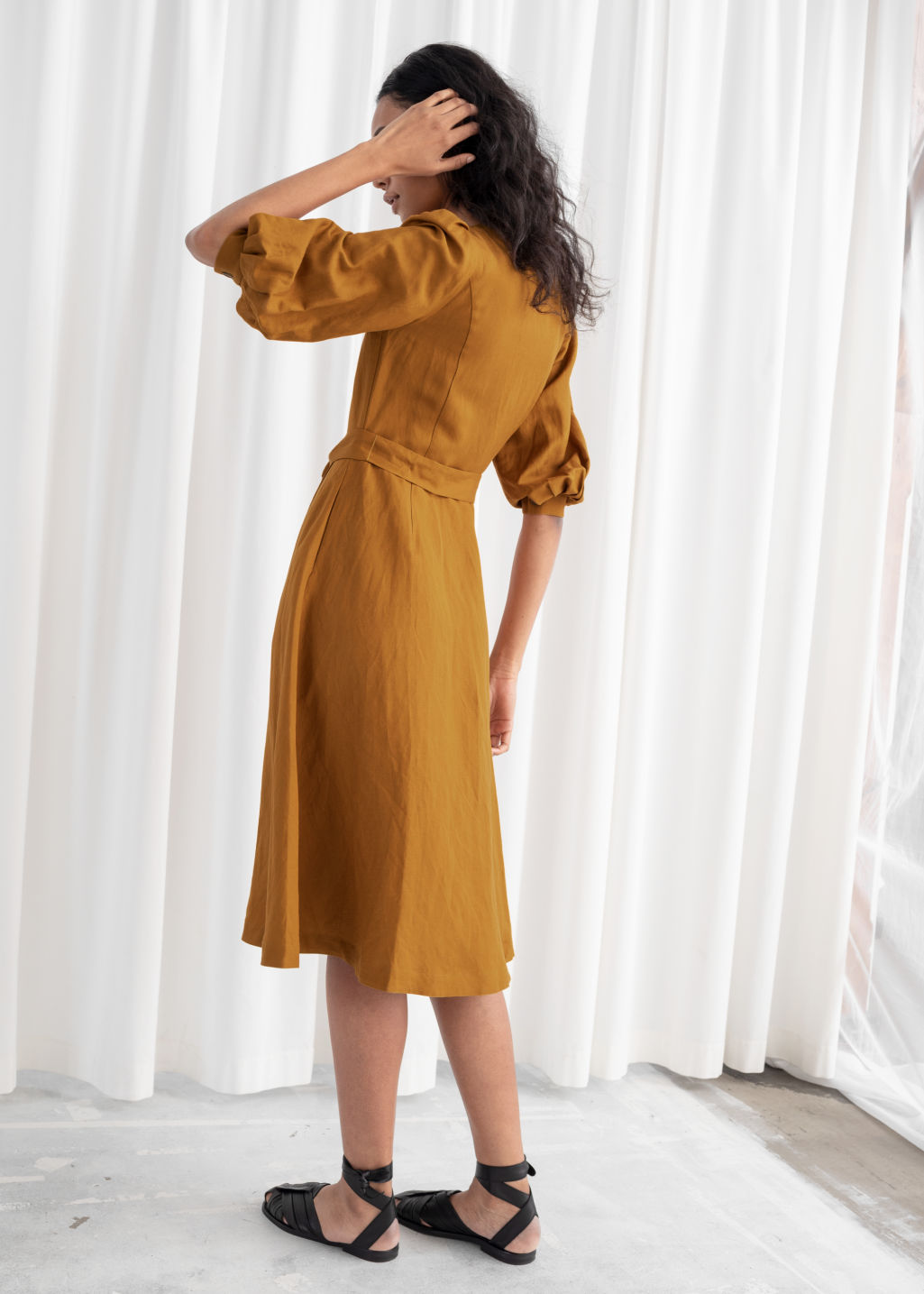 Model back image of Stories belted linen blend midi dress in yellow