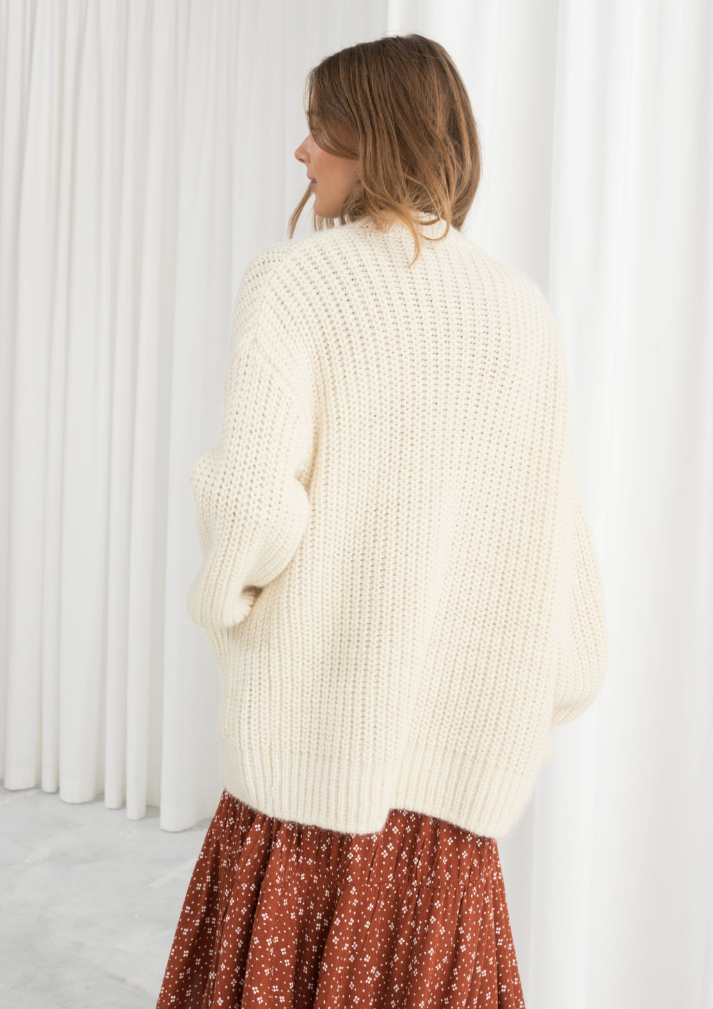 Model back image of Stories overzied rib knit cardigan in white