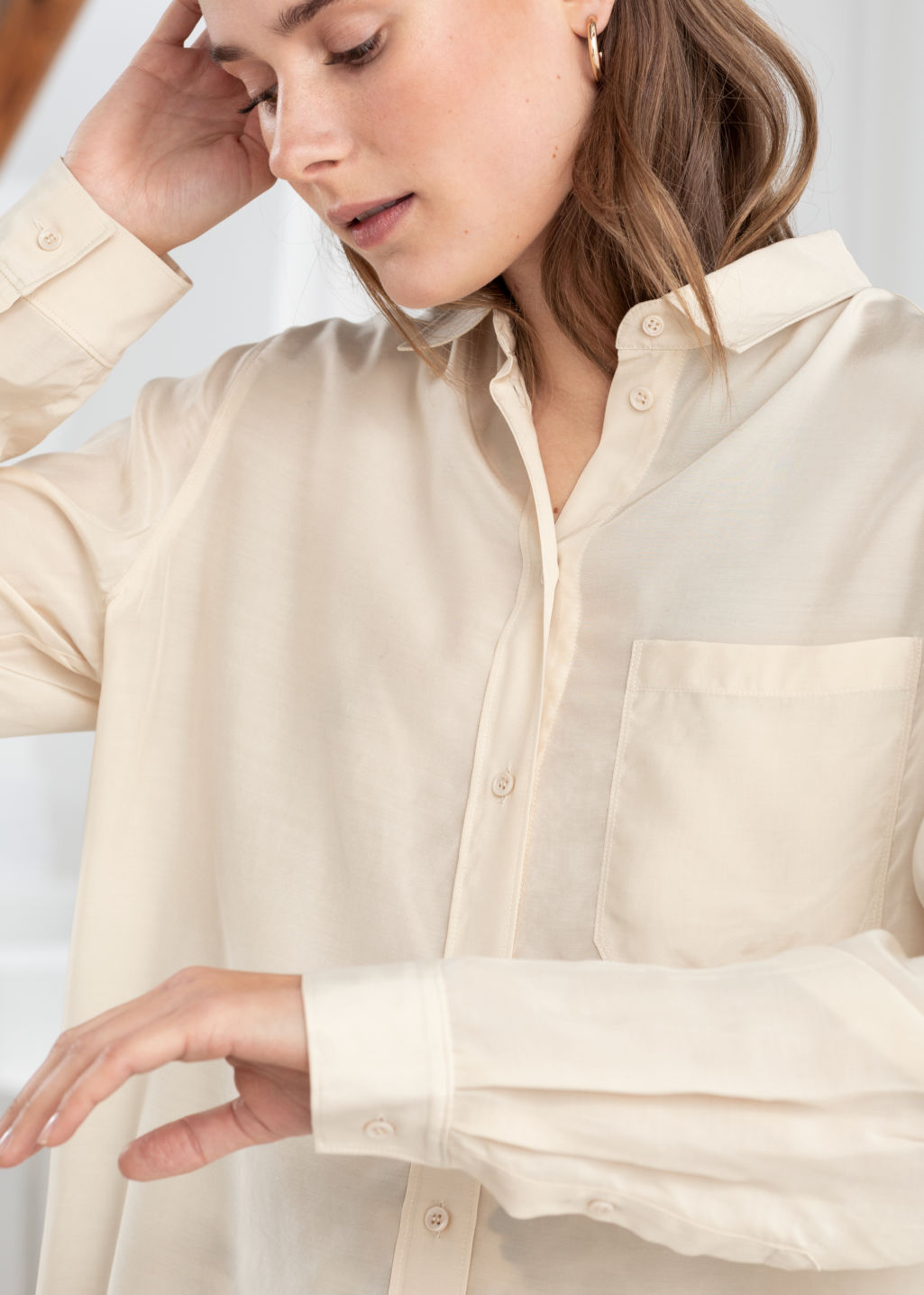Model back image of Stories modal blend button up shirt in beige