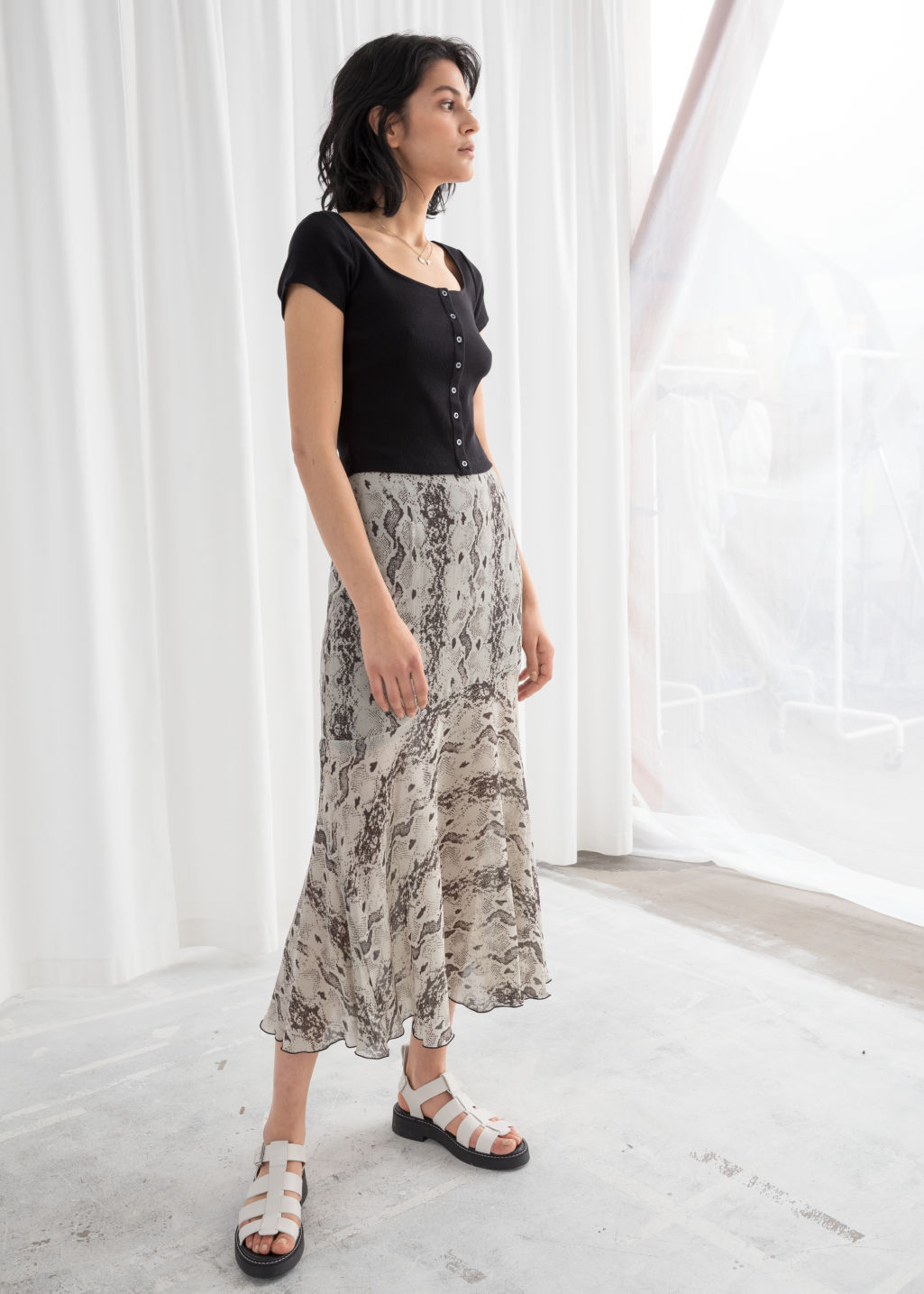 Model front image of Stories floral print midi skirt in beige
