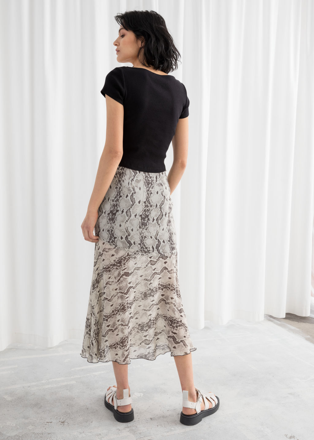 Model back image of Stories floral print midi skirt in beige