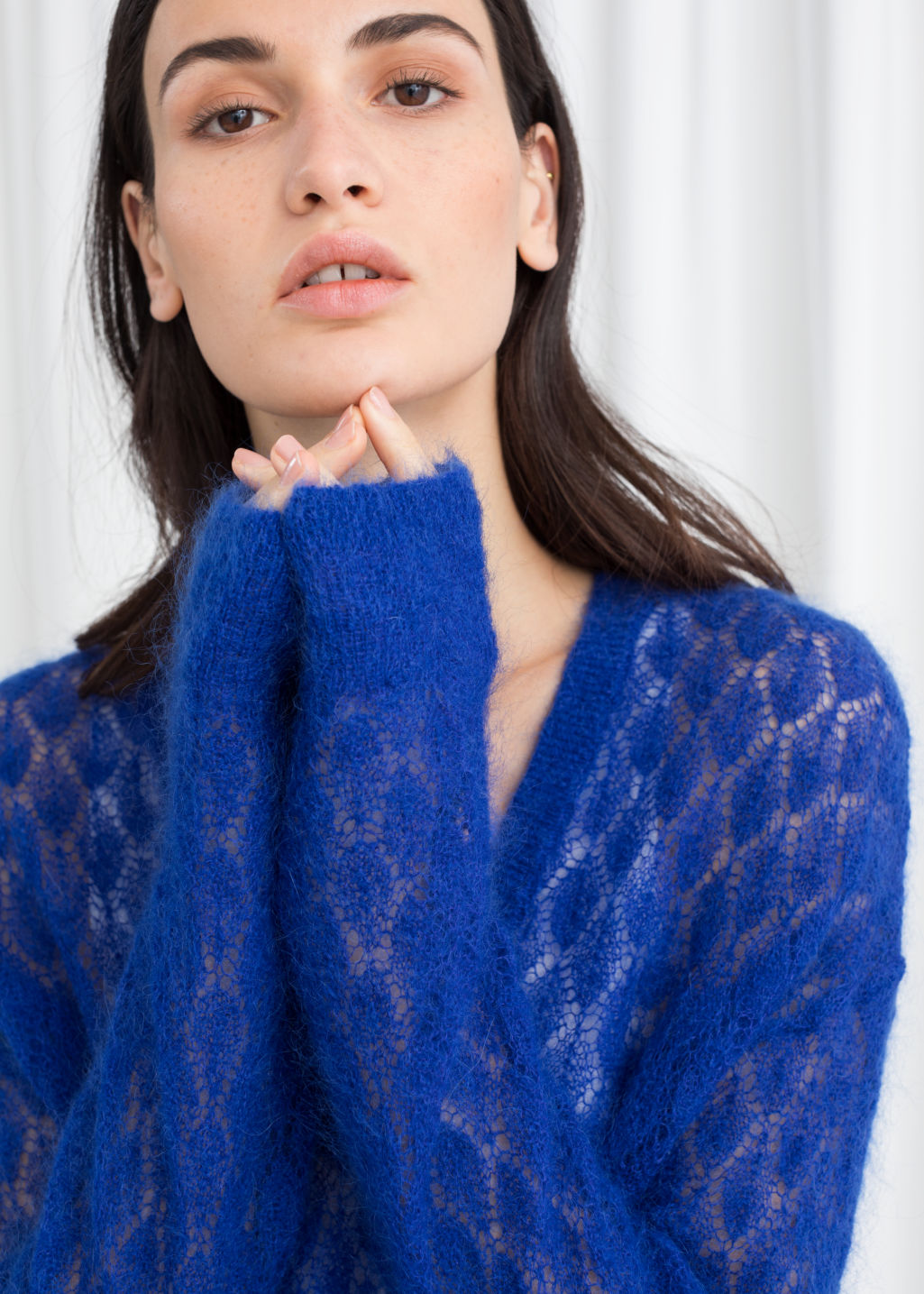 Model front image of Stories diamond stich knit sweater in blue