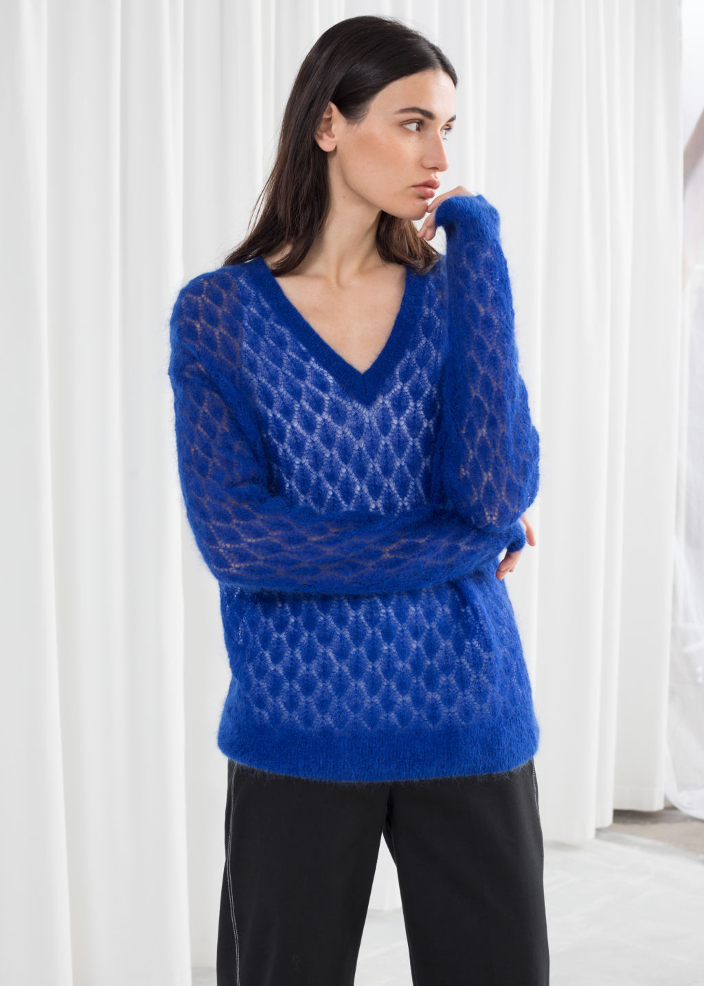 Model back image of Stories diamond stich knit sweater in blue