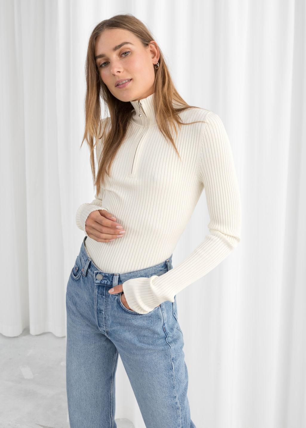 Model front image of Stories zippered rib knit turtleneck in white