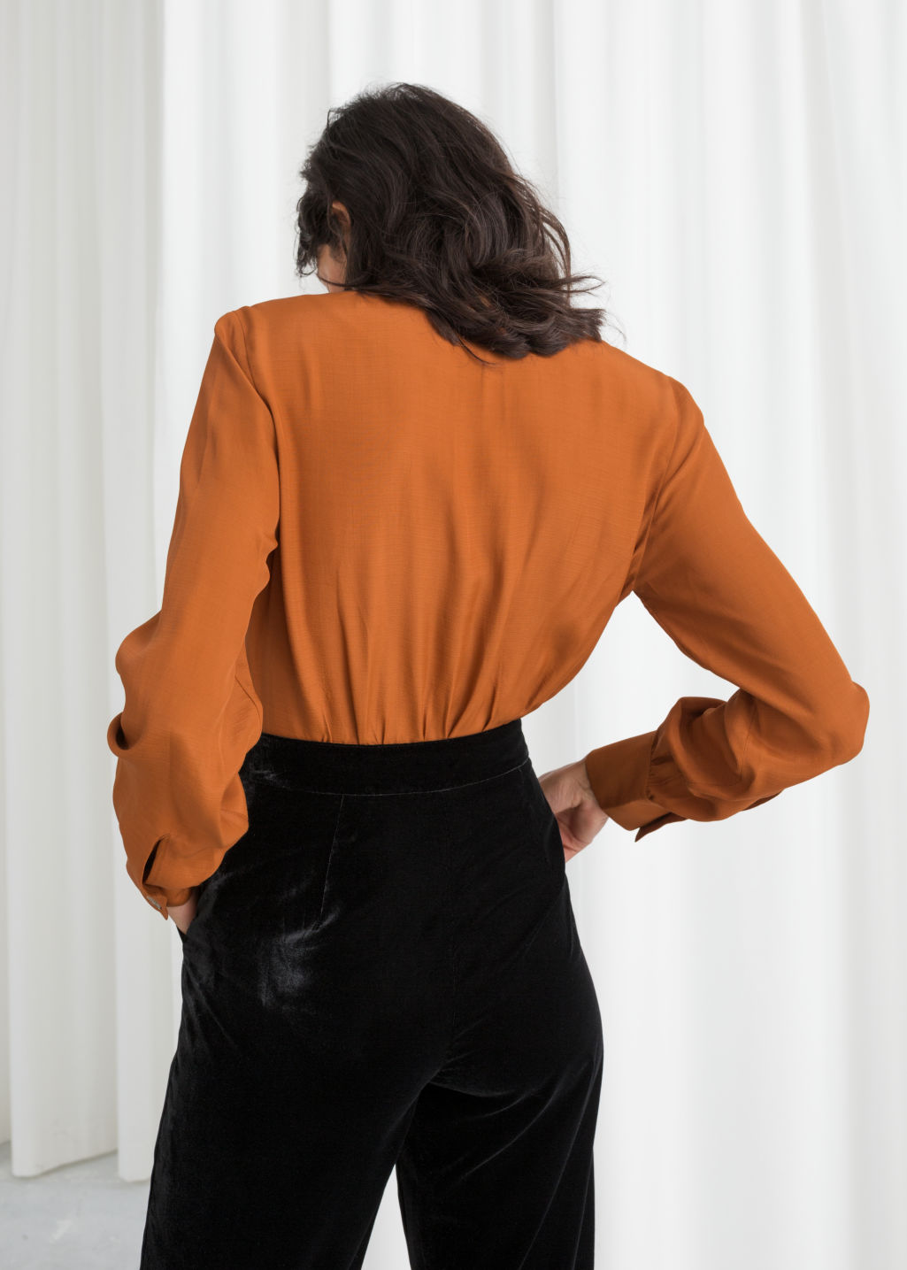 Model front image of Stories v-cut button up blouse in orange