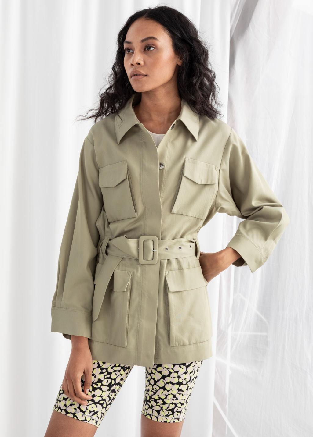 Model front image of Stories oversized belted workwear jacket in beige