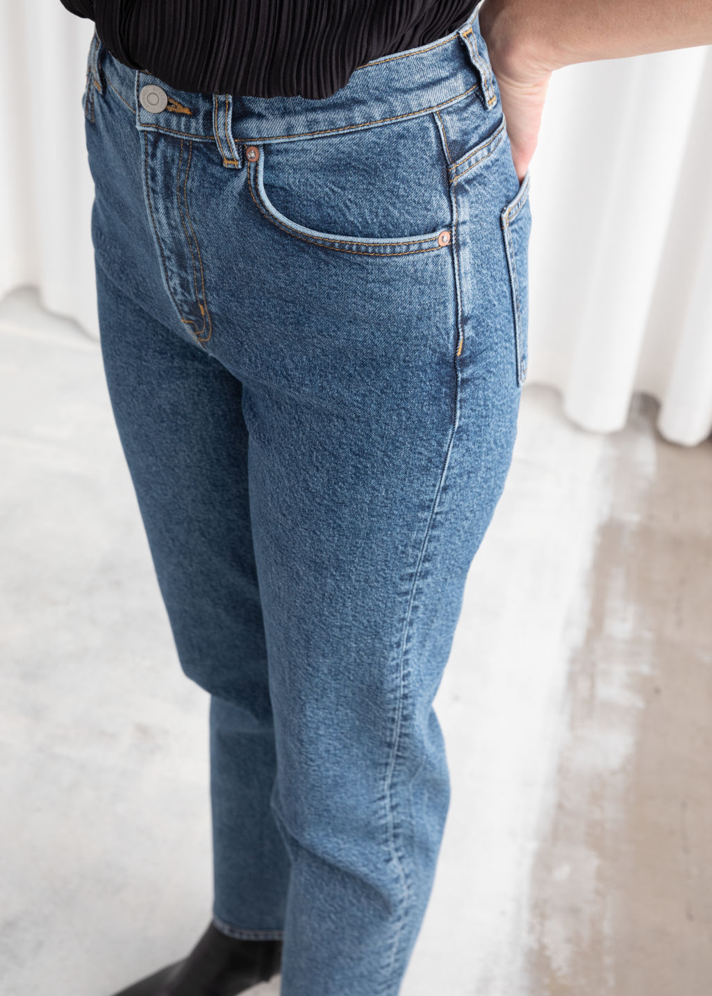 Model back image of Stories tapered high rise jeans in blue