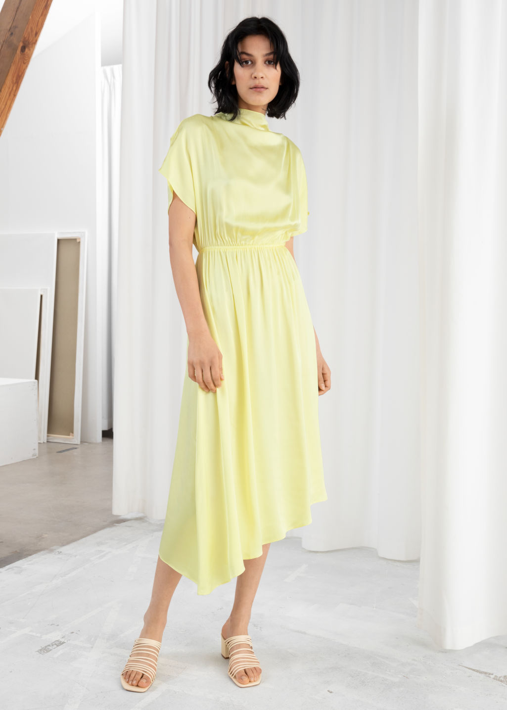 Model front image of Stories asymmetric satin midi dress in yellow