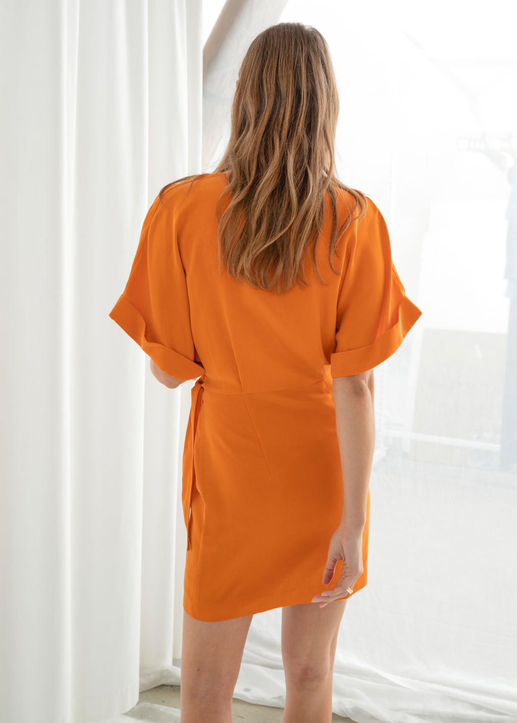 Model back image of Stories  in orange