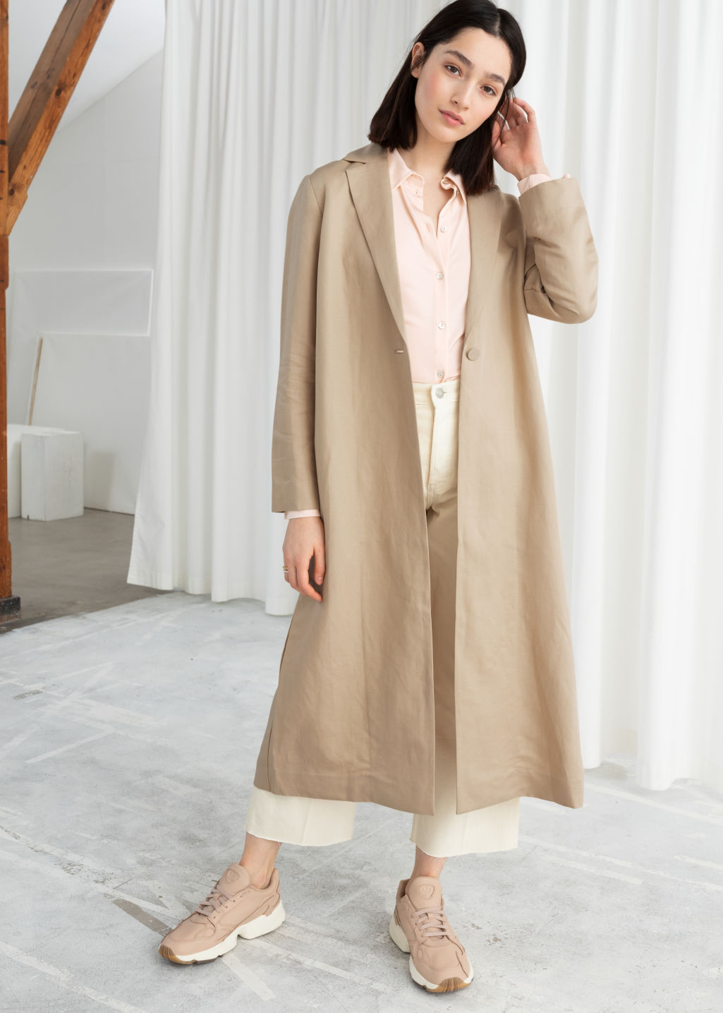 Model front image of Stories linen blend duster coat in beige
