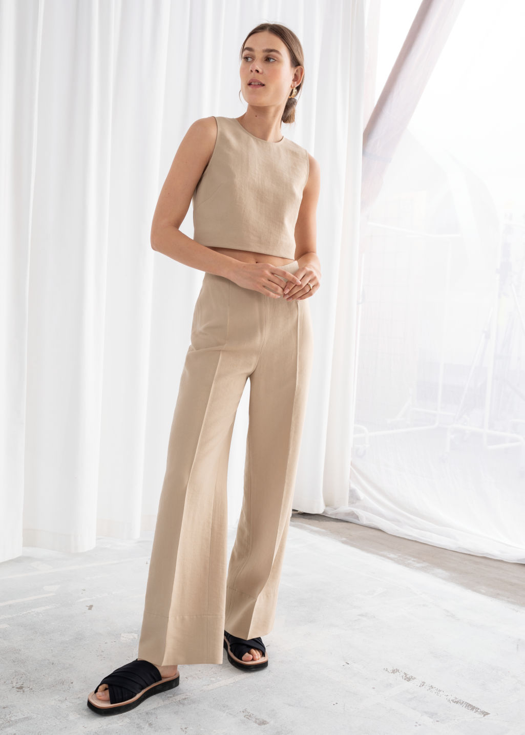 Model front image of Stories wide lyocell blend trousers in beige