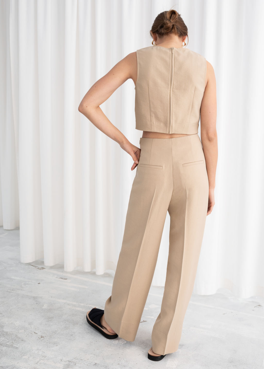 Model back image of Stories wide lyocell blend trousers in beige