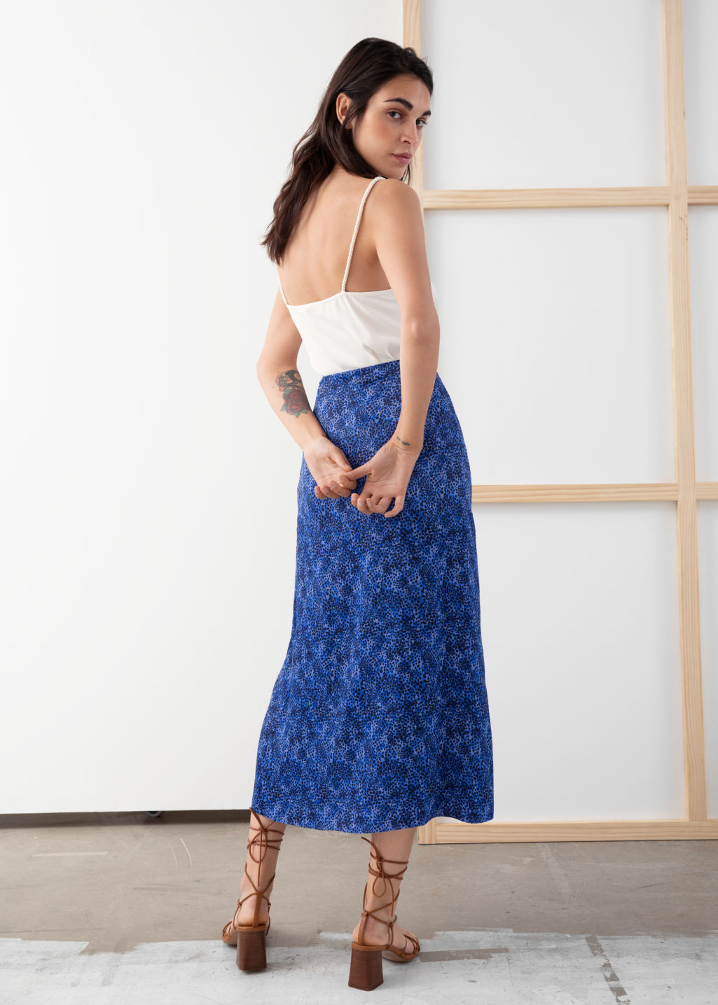Model back image of Stories side slit satin midi skirt in blue