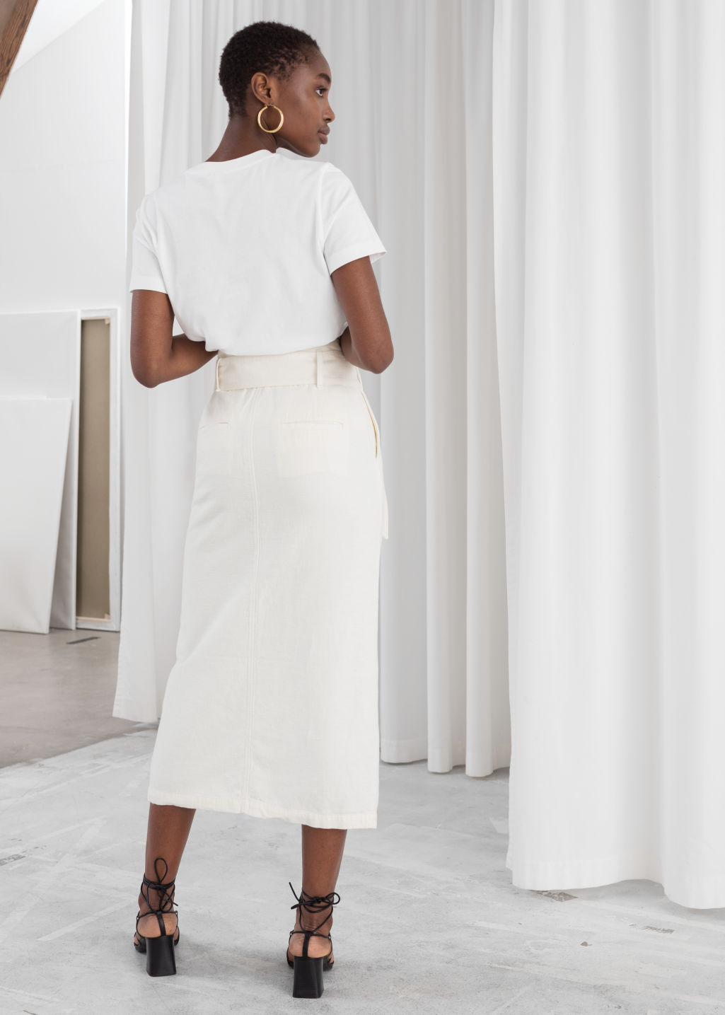 Model back image of Stories linen blend paperbag waist midi skirt in white