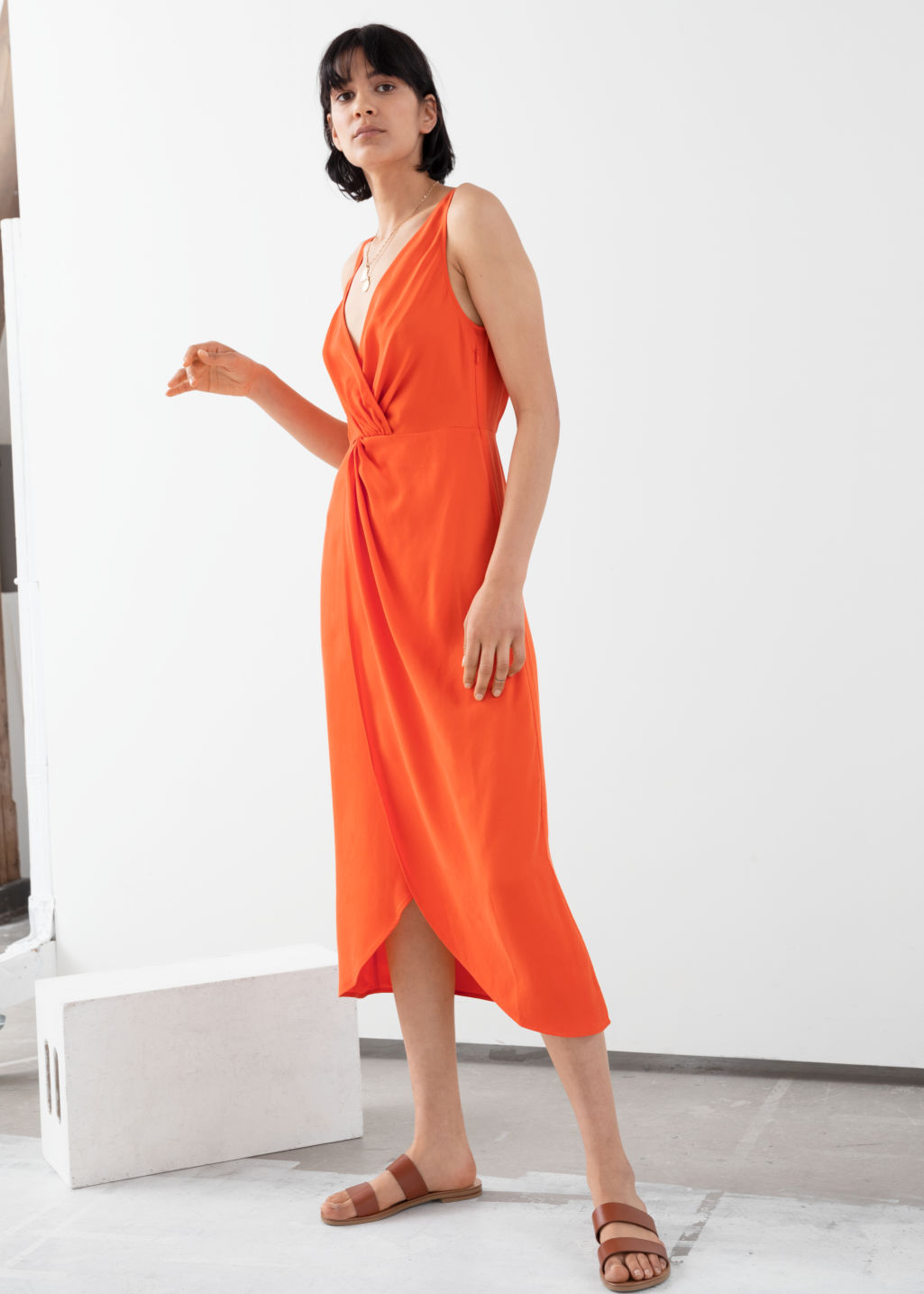 Model front image of Stories sleeveless lyocell twist knot midi dress in orange