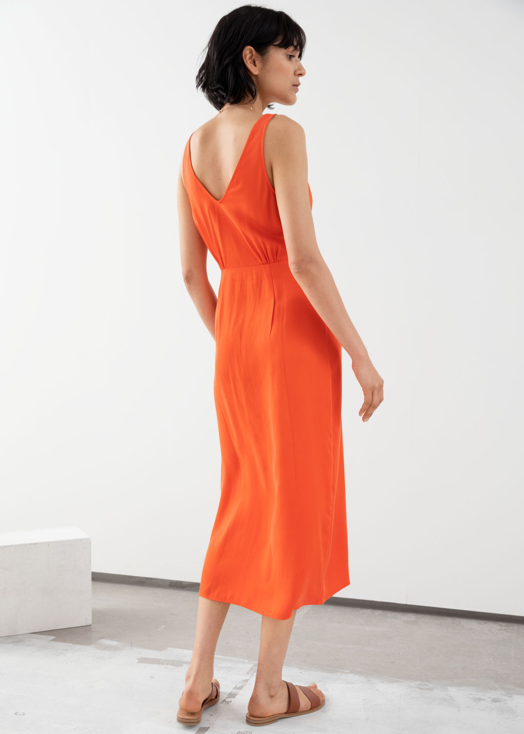 Model back image of Stories sleeveless lyocell twist knot midi dress in orange