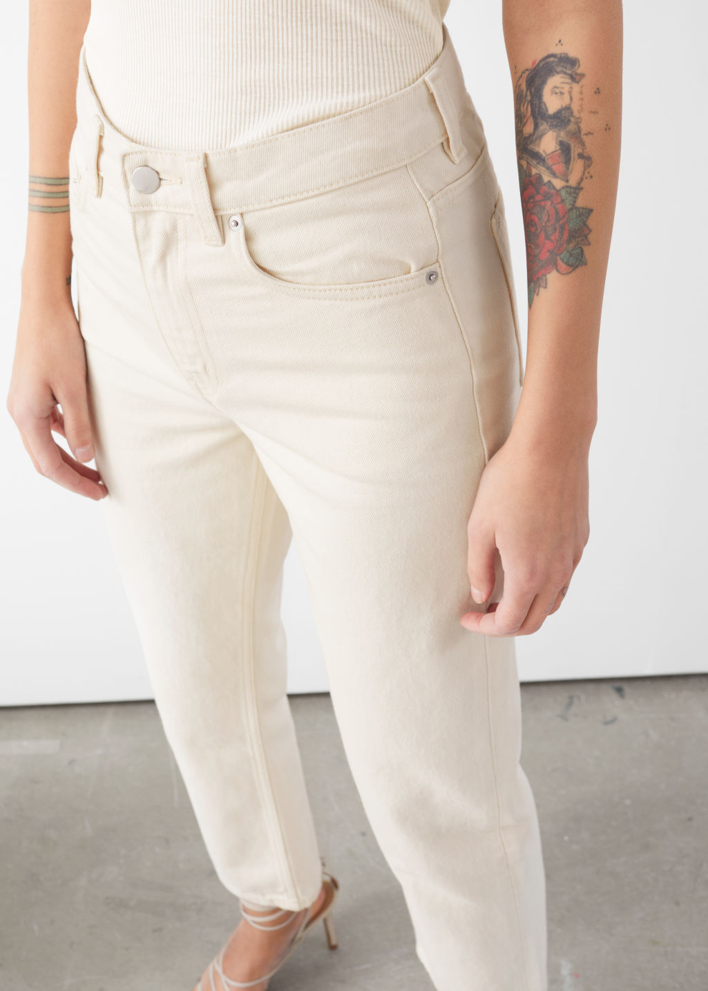 Model front image of Stories tapered mid rise jeans in white