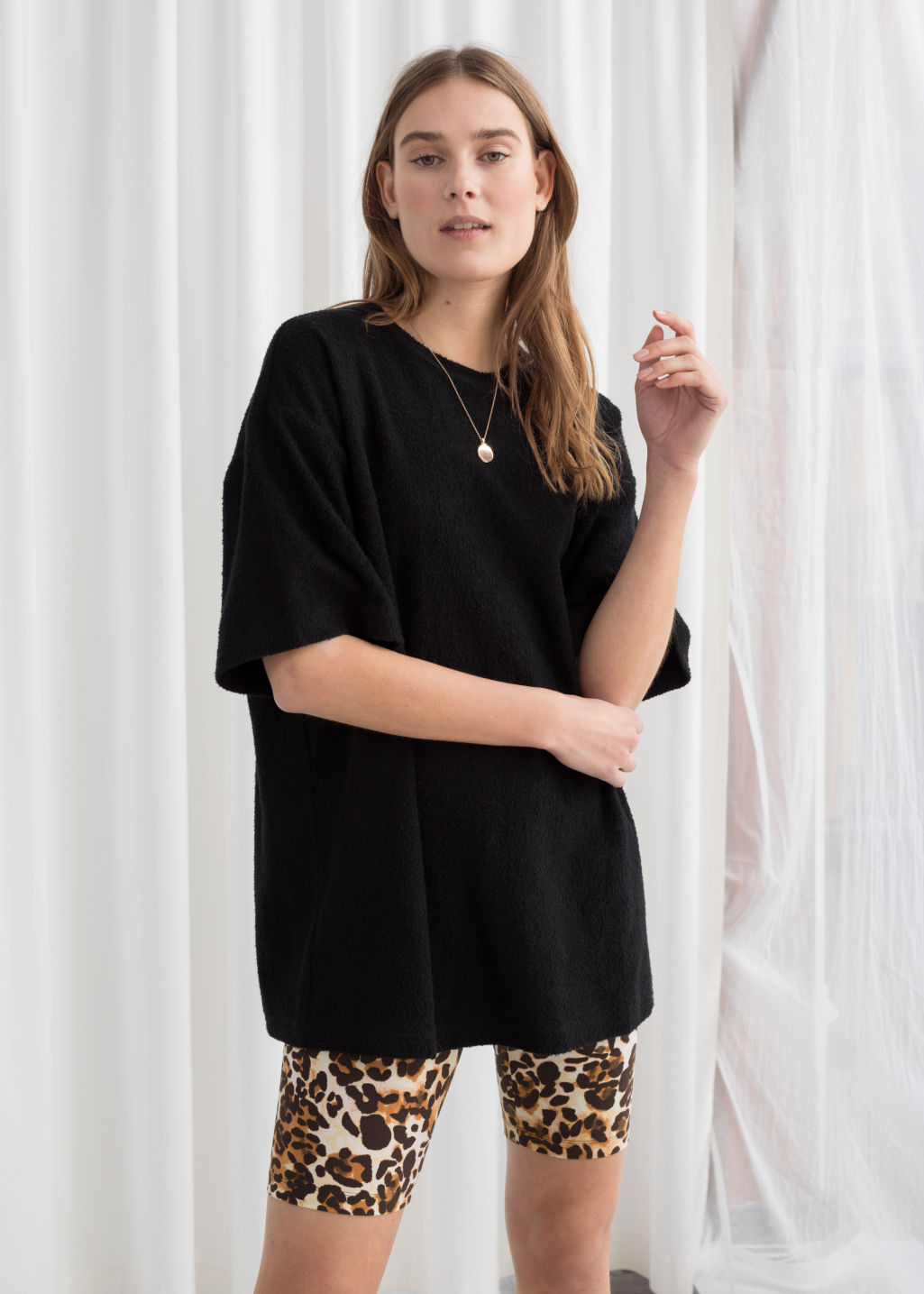 Model front image of Stories oversized cotton tee in black