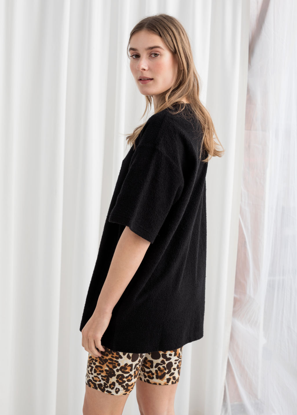 Model back image of Stories oversized cotton tee in black