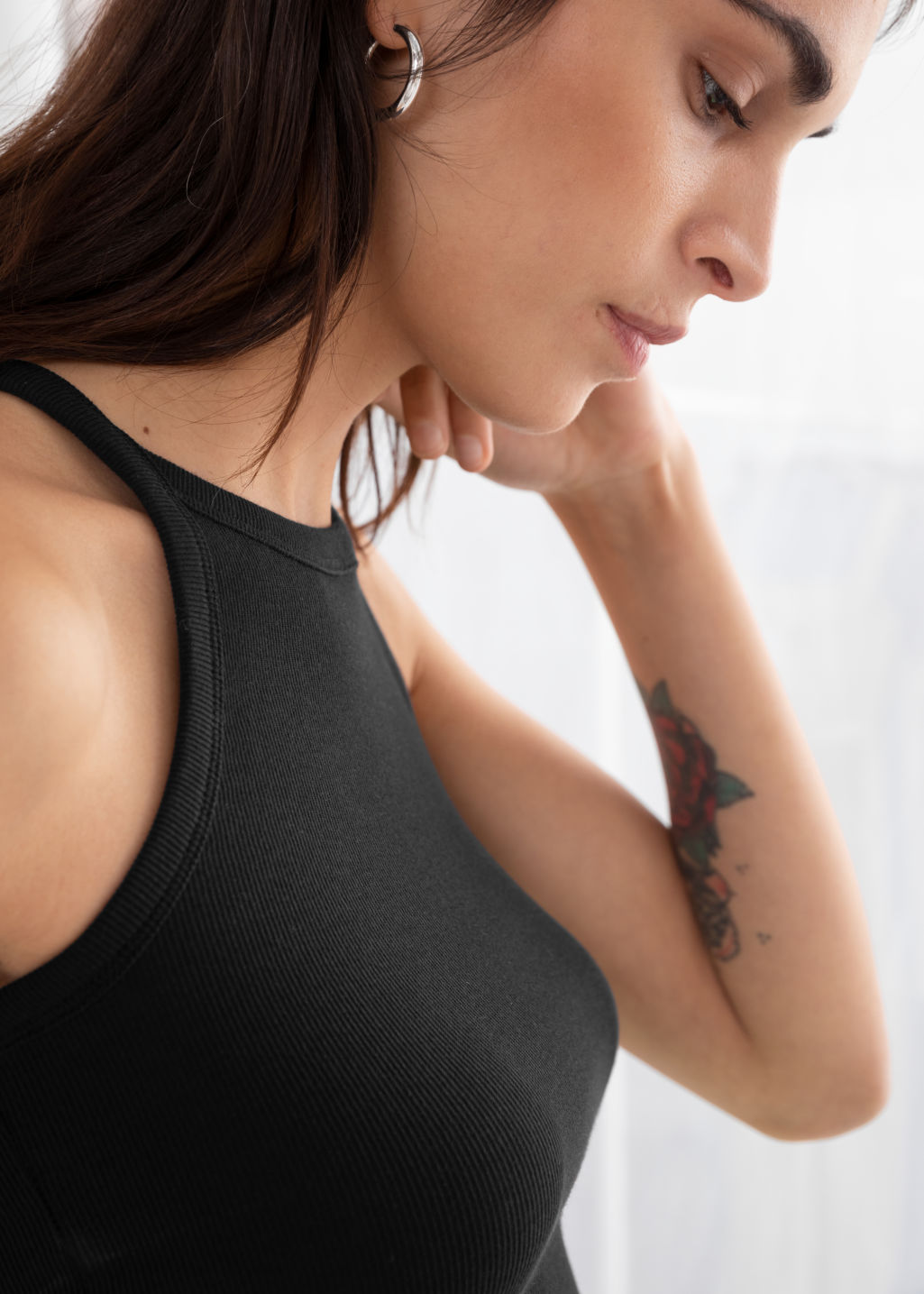 Model back image of Stories racer cut cotton tank top in black