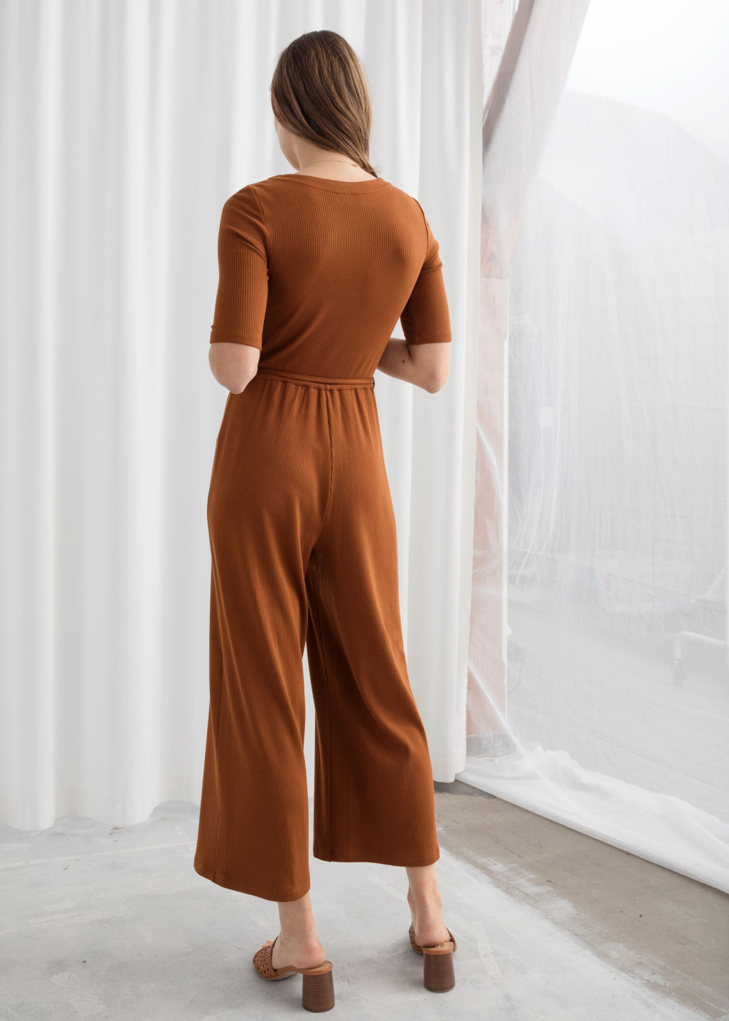 Model back image of Stories stretch rib knit jumpsuit in beige